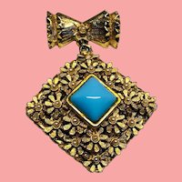 Exquisite Bow Brooch with Turquoise Stone