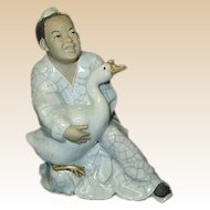 Chinese Man Holding Goose Figurine
