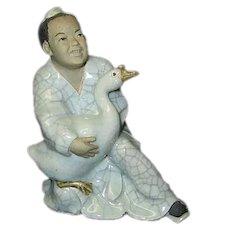 Chinese Mudman Holding Goose Figurine
