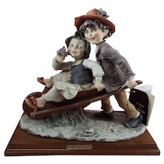 "G. Armani Florence Figurine ""Boy pushing Girl in Wheelbarrow.""  1982"