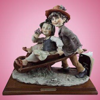 """G. Armani Florence Figurine """"Boy pushing Girl in Wheelbarrow.""""  1982"""