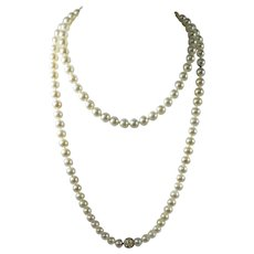 Akoya Saltwater Peal Necklace with 1.56 ct Diamonds 38 inches long