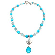Sleeping Beauty Turquoise, Natural Aquamarine, Natural Cultured Baroque Pearls support a Pendant of Turquoise, Pearl and Blue Topaz