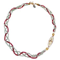 A Braided Necklace of Natural Pink Garnets and Natural Celadon Aventurine with an Art Nouveau 10K Gold, Enamel, Garnet and Pearl Pendant