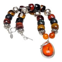 """Amber in """"Art Nouveau"""" Sterling Silver on  Tiger's Eye, Horn,  Sterling Silver"""