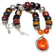 "Amber in ""Art Nouveau"" Sterling Silver on  Tiger's Eye, Horn,  Sterling Silver"