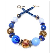 Statement Necklace of Natural Lapis, Gold Leaf Nepalese Wood, Venetian Glass, Natural Blue Lace Agate, and  Tibetan Brass
