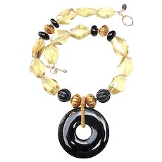 Natural Lemon Quartz Natural Onyx and Traditional Gold Plated Beads Support a Polished Natural Onyx Bi Disc