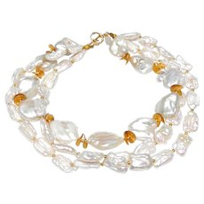 Three Strands of Large, Cultured, Naturally White, Baroque Flat Pearls, with Vermeil Discs