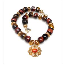 Vermeil Pendant from Afghanistan set with a Carnelian Cabochon, on a Necklace of Natural Tiger's Eye and Traditional Vermeil Beads