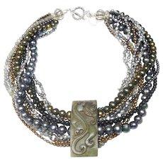 Multi strands of Natural, Baroque, Cultured Pearls, Onyx, Labradorite and Hematite Glide Through a Nephrite Jade Sword Slide