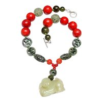 Antique Jade Baby on Natural Green Jadeites and Sponge Coral