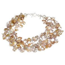 Three Strands of Cultured Keshi Pearls in Silver/Gold
