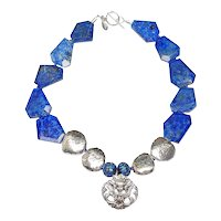 An Angel in Silver Soars with Brilliant Blue Lapis