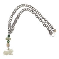 Jade Hare Runs with 0n a Grey Silk Chain