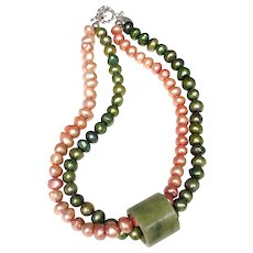 Jade Chinese Thumb Guard on Two Strand Pearl Necklace