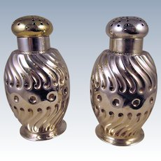 A Pair Of Durgin Sterling Silver Muffineers