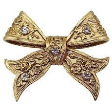 "Pretty Vintage Gold Tone Bow Brooch / Pin with Rhinestones 1.5"" x 1 3/8"""