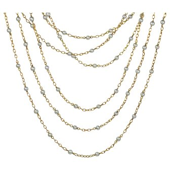 French 18kt gold and natural pearl 161cm long chain