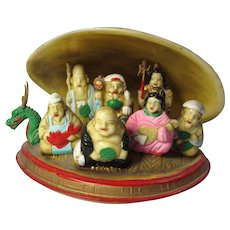 Vintage 7 Chinese Immortals in Clamshell Boat Sculpture