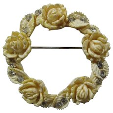1920s Carved Celluloid Floral Wreath Brooch With Rhinestones