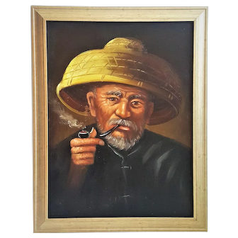 An original vintage oil painting on canvas of an Asian man with straw hat and pipe.