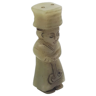 A Shang dynasty Jade carving of a standing dignitary