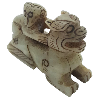 A rare Jade carving of a Ming dynasty with a unique figure of a foo dog and a monkey on its back