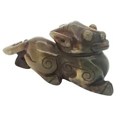 A Han dynasty Hetian jade carving of a charging tiger figure