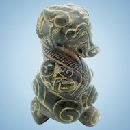 A Han dynasty brown jade ram beast