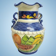 A vintage Italian hand-carved, hand-painted ruffle top double handled ceramic vase. FREE US SHIPPING
