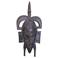 An antique hand-crafted tribal art mask from the Senufo Tribe Ivory Coast Ghana