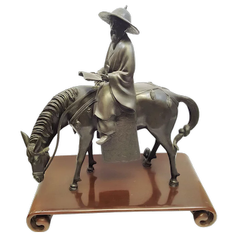 A vintage Japanese bronze statue of Toba on mule