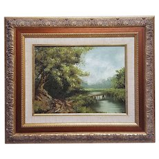 A vintage oil painting on canvas landscape signed Wilson