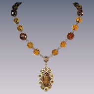 Czechoslovakian lavaliere rhinestone necklace hand cut crystal beads floral motif.