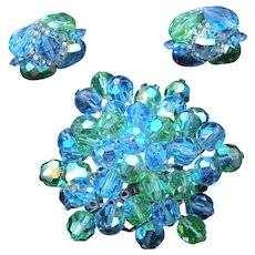 Vintage Vendome crystal brooch and earrings set.  This is green aurora borealis faceted crystal.Pristine