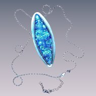 Artisan Dichroic pod pendant in silver bezel