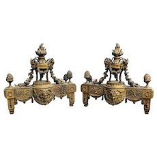 A large pair of French Louis XVI style gilt-bronze chenets