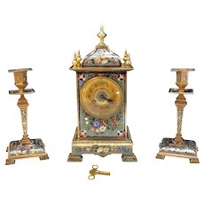 French gilt brass and champleve enamel garniture clock set
