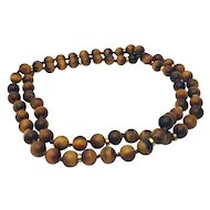 Tiger's Eye Necklace w/ 14k Yellow Gold Spacers. 32 inches w/appraisal