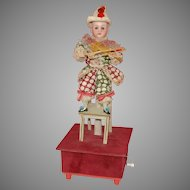 Movement Music Crank * Clown sitting on chair & playing violin * made at 1890