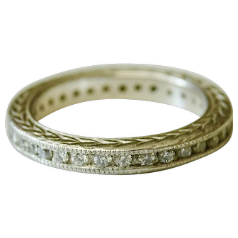 Diamond eternity band with 33 full-cut, round diamonds.