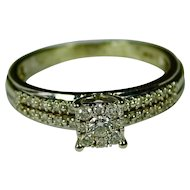 Engagement style ring 9 diamond cluster head 8 diamonds on each side