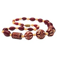 Carved Galalith Cranberry Red and Cream Bead Necklace French Bakelite