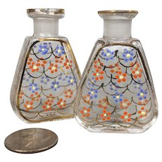 Two miniature perfume bottles