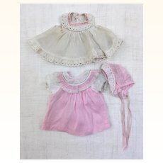 Two vintage doll dresses and bonnet