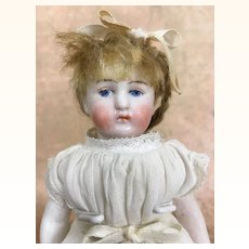 Antique all bisque Kestner girl doll with pink boots