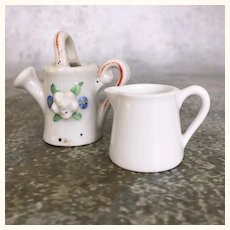 Two miniature porcelain pitchers