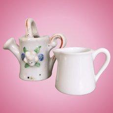 Two miniature porcelain pitchers