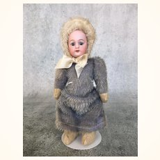 Petite German bisque head doll in mohair Snow Baby suit